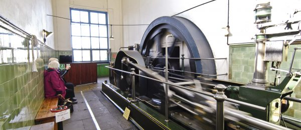 A photo of steam engine machinery inside the Queen Street Mill