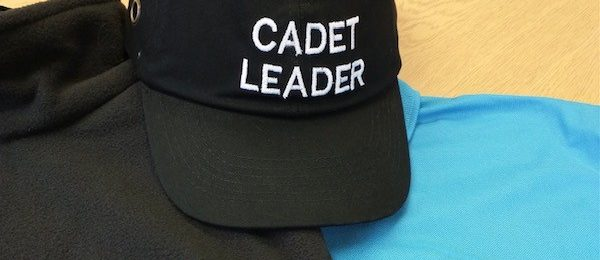 Cadet leader hat with blue polo shirt and black fleece